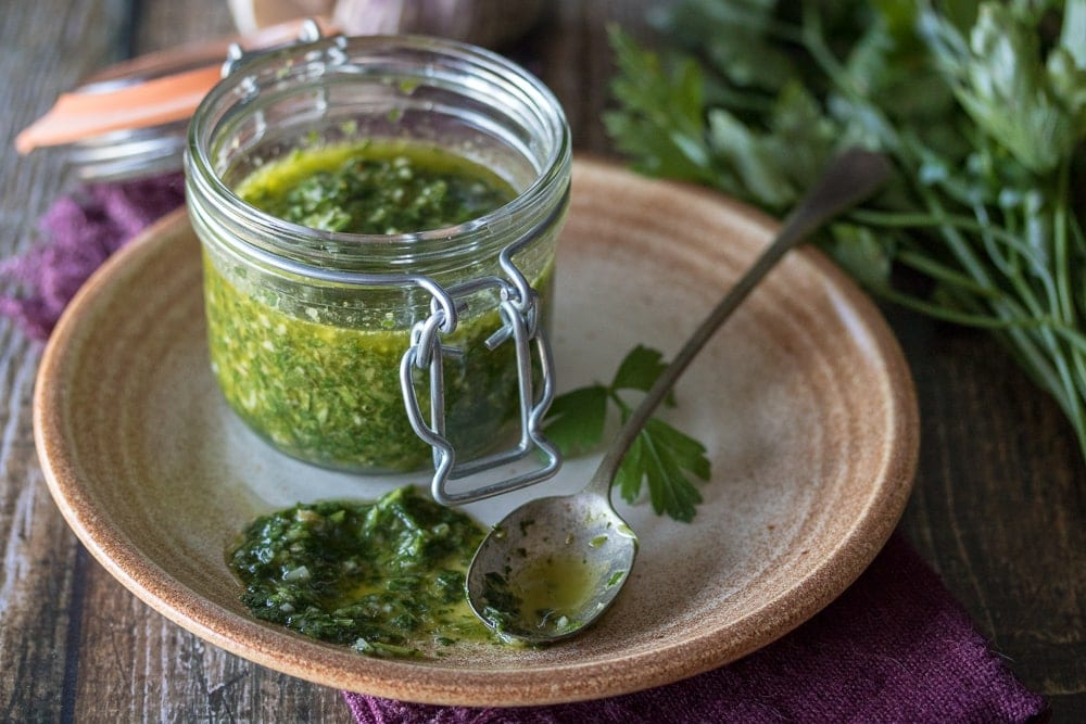 There's nothing like this easy chimichurri sauce to brighten up your favorite dish! Five minutes and a basic food processor are all you need to put together this delicious and versatile condiment. This simple Chimichurri recipe is easy to make!