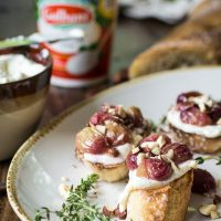 Roasted Grape Crostini with Whipped Ricotta and Hazelnuts