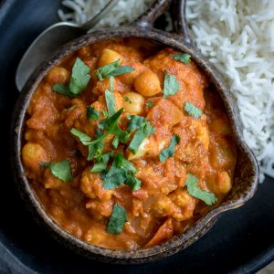 This delicious (and Vegan!) Chickpea Tikka Masala recipe hits the spot when you're craving Indian food. Serve it up over rice and garnish with plenty of fresh cilantro!