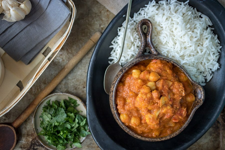 This delicious vegan chickpea masala recipe hits the spot when you're craving Indian food. Serve it up over rice and garnish with plenty of fresh cilantro!