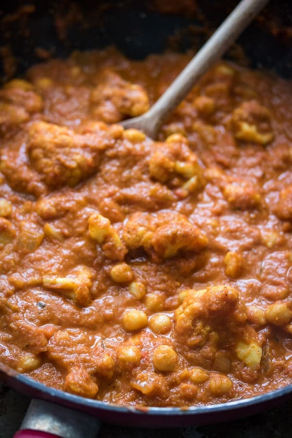 This delicious chickpea masala vegan recipe hits the spot when you're craving Indian food. Serve it up over rice and garnish with plenty of fresh coriander!