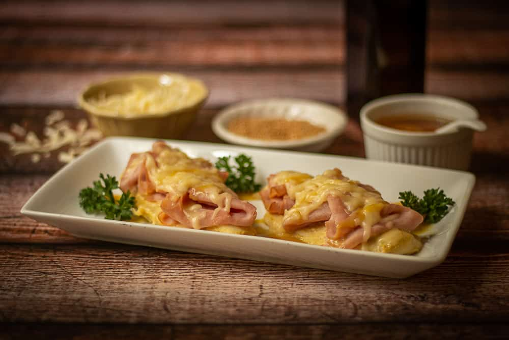 This easy, gluten free chicken cordon bleu recipe combines the sweet and tangy flavors of honey and Dijon mustard with baked chicken, ham and melted Swiss cheese for a tasty dish!