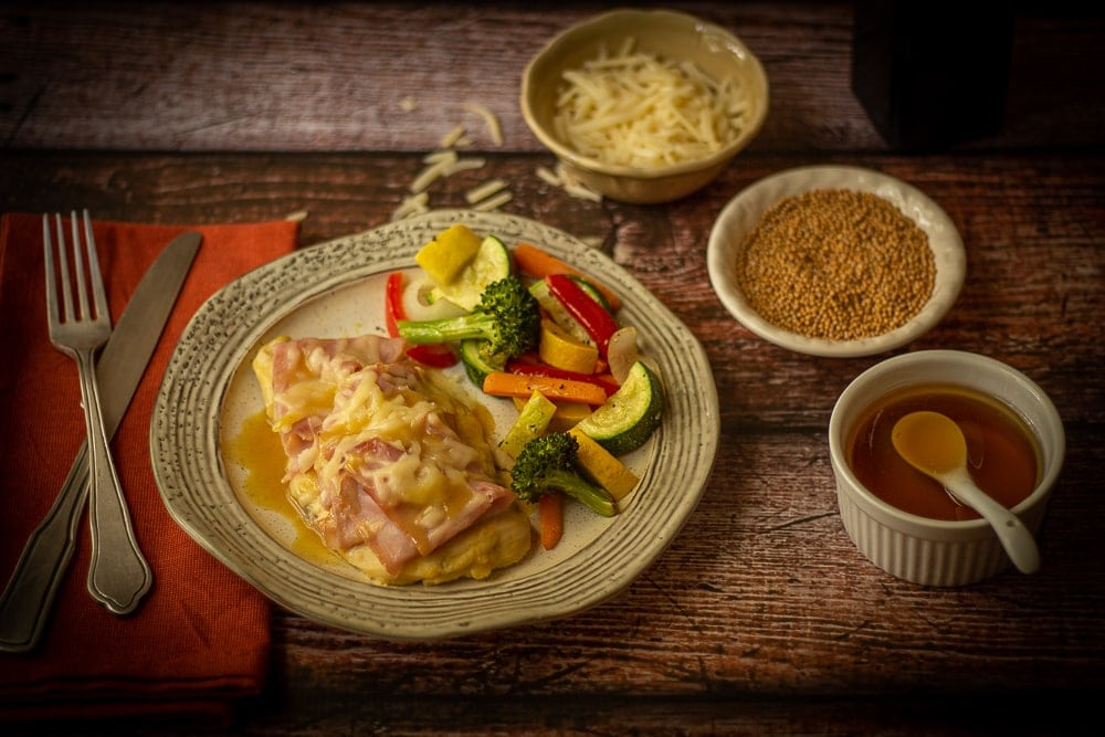 This simple chicken cordon bleu recipe combines the sweet and tangy flavors of honey and Dijon mustard with baked chicken, ham and melted Swiss cheese for a tasty dish!