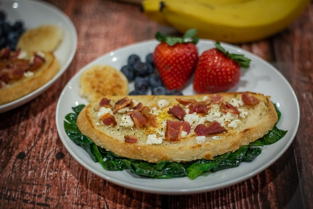 This European Bird in the Nest recipe combines crunchy Italian bread and French seasonings with tangy goat cheese and bacon to create a tasty way to start your morning!