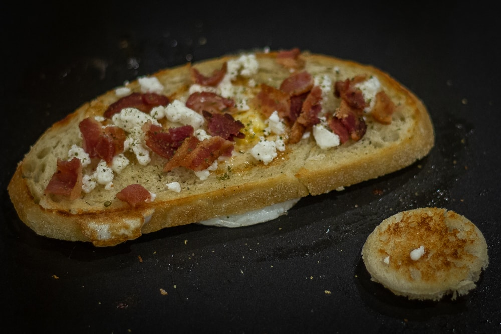 This European Birds in the Nest recipe combines crunchy Italian bread and French seasonings with tangy goat cheese and bacon to create a tasty way to start your morning!