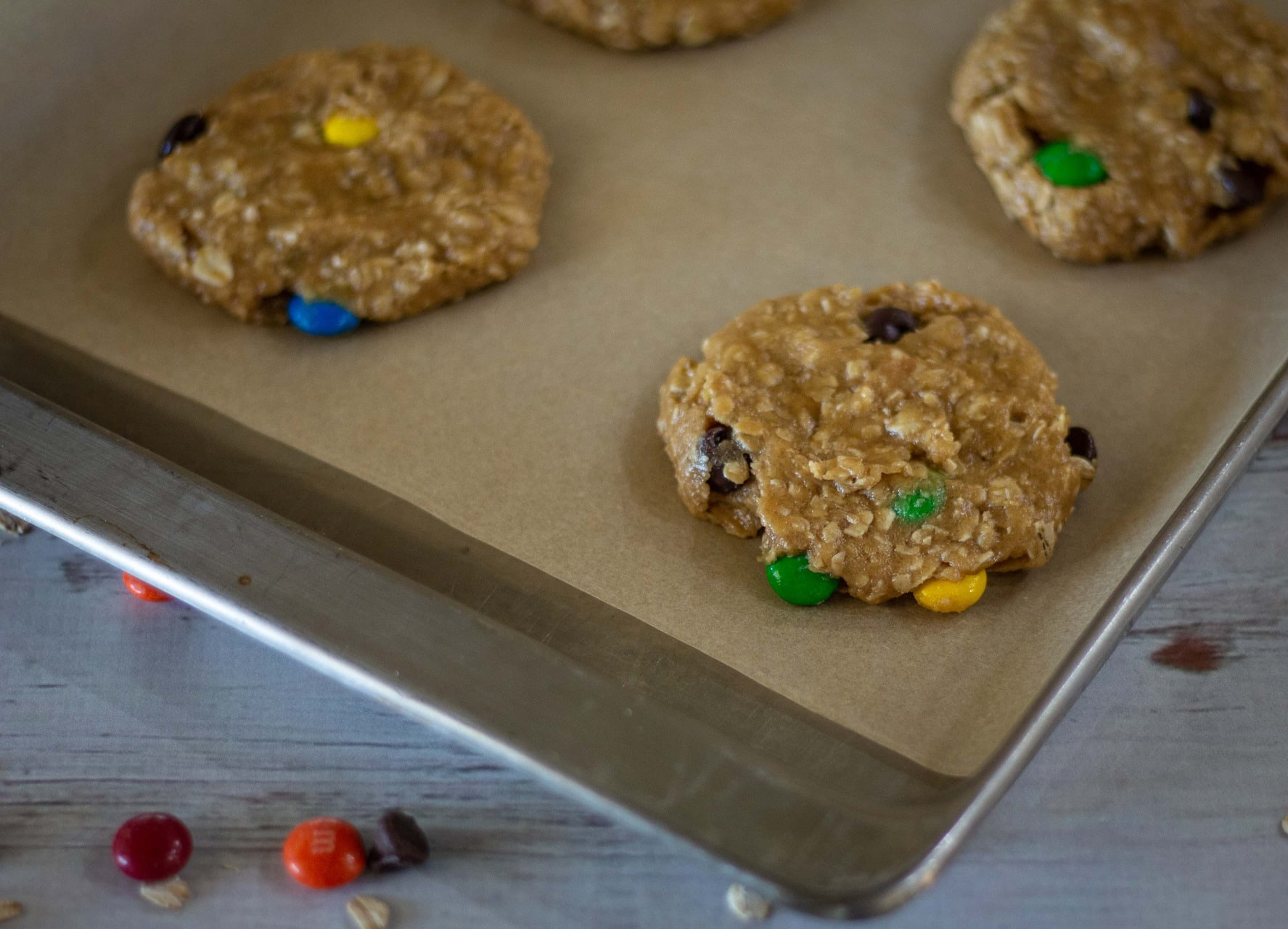 This Monster Cookies recipe combines peanut butter, oats, chocolate chips and M&M's for a giant, chewy cookie that will become a family favorite. Use different colored M&M's to make these giant monster cookies for any holiday or occasion!