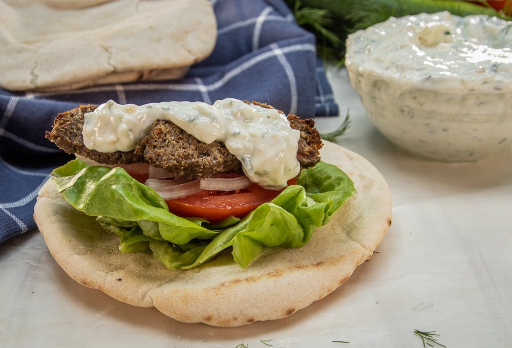 This Beef Gyro recipe with Authentic Greek Tzatziki Sauce is a delicious combination of flavors from red onion, garlic, marjoram, rosemary, oregano, salt and pepper that you can easily make at home.