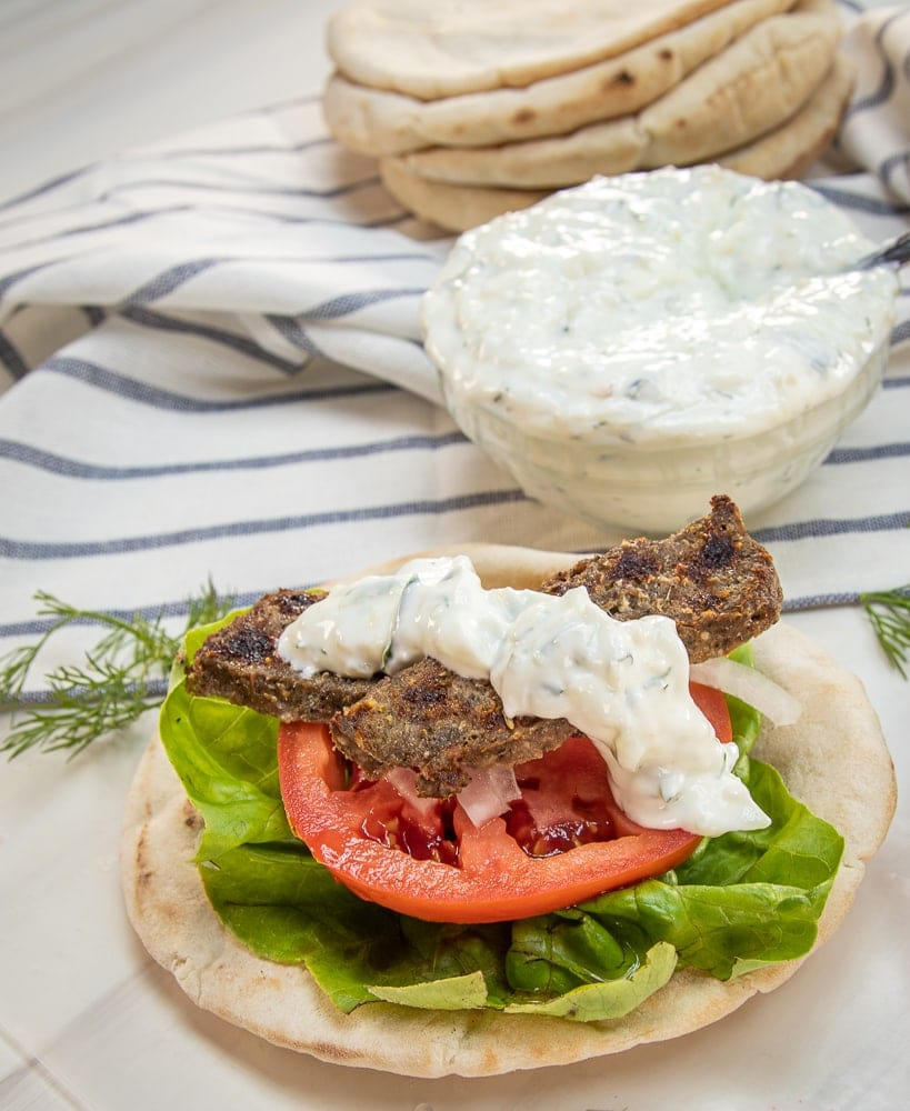 This Gyro recipe with Authentic Greek Tzatziki Sauce is a delicious combination of flavors from red onion, garlic, marjoram, rosemary, oregano, salt and pepper that you can easily make at home.