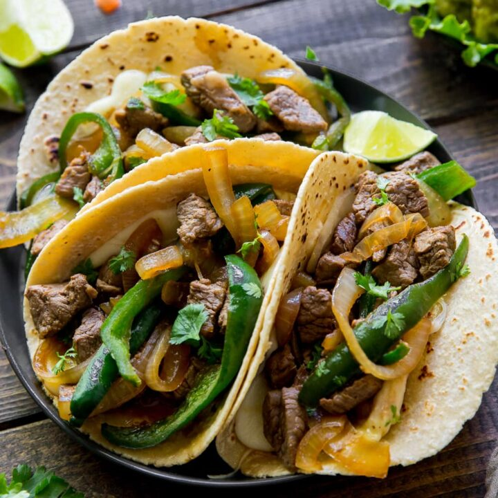 This Asadero Cheese and Steak Tacos recipe uses beef tenderloin, onions, poblano peppers, spices and a secret sauce on top of Mexican Asadero Cheese for a delicious, Tex-Mex Taco you will love!
