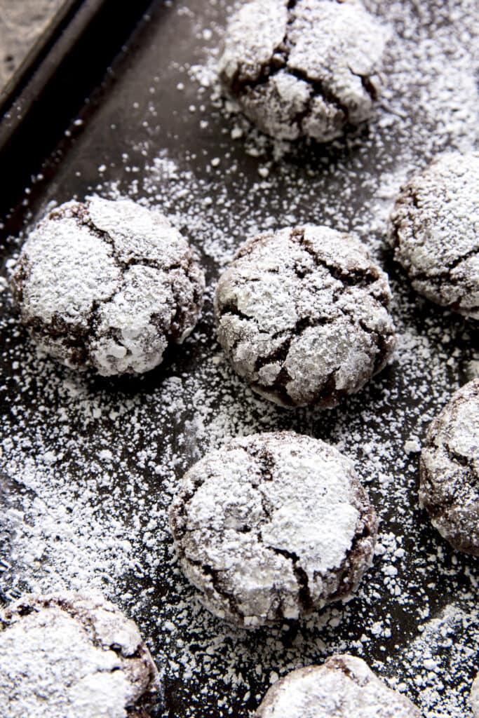 This Chocolate Crinkles recipe is one of our family favorites for the holidays with melted chocolate, chocolate chips, healthy oats and rolled in powdered sugar for a little chocolate snowball cookie!