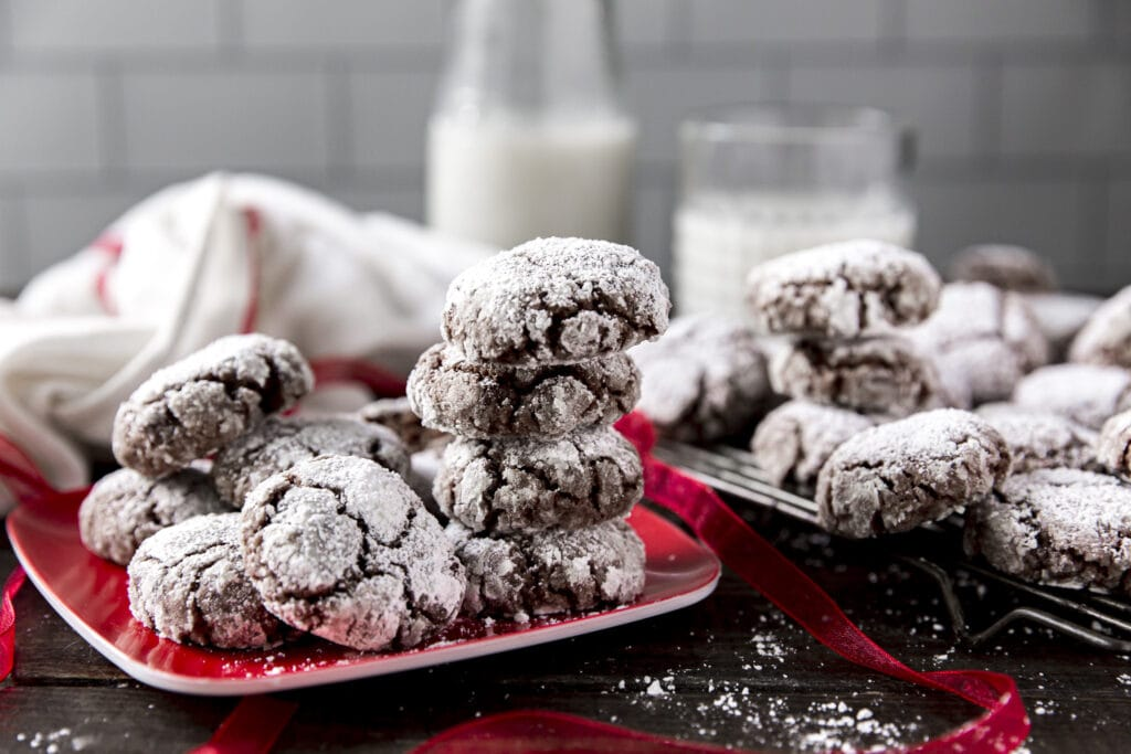 This Chocolate Crinkle Cookies recipe is one of our family favorites for the holidays with melted chocolate, chocolate chips, healthy oats and rolled in powdered sugar for a little chocolate snowball cookie!