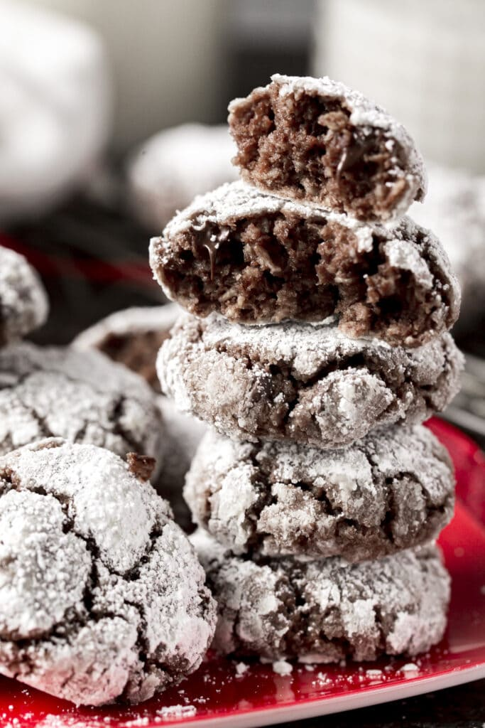 This Chocolate Crinkle Cookies with butter recipe is one of our family favorites for the holidays with melted chocolate, chocolate chips, healthy oats and rolled in powdered sugar for a little chocolate snowball cookie!