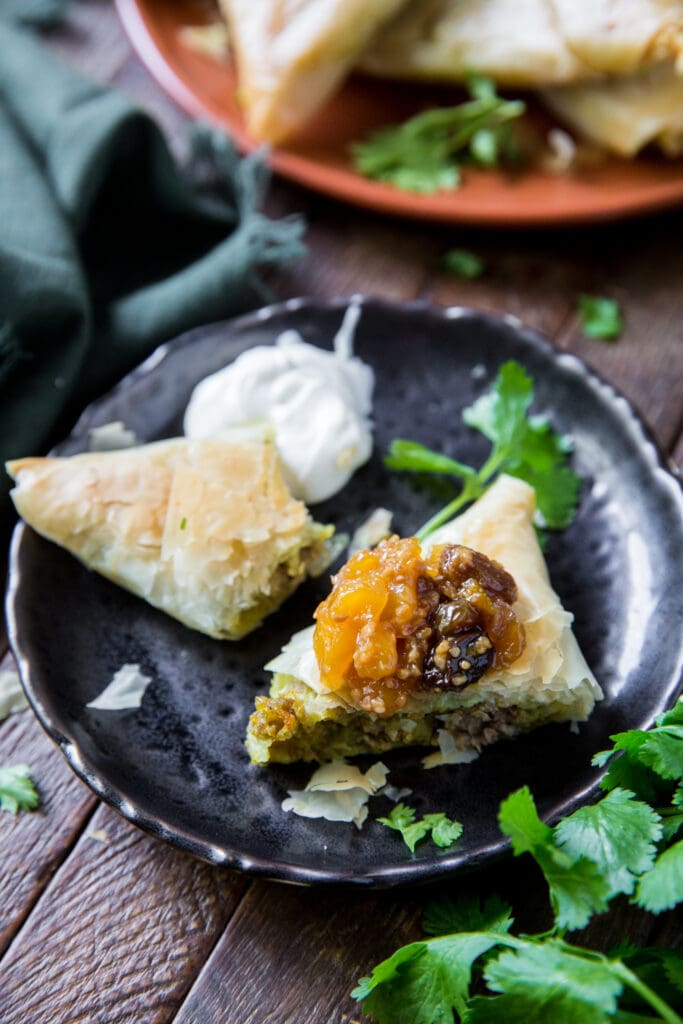 This Baked Beef Samosa recipe is a delicious combination of lean beef, potatoes, peas, sweet yellow onions and spices wrapped up in a golden pastry shell for a savory, crunchy appetizer.