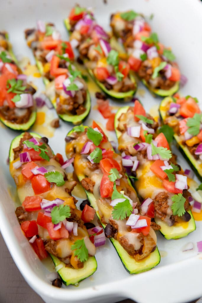 This delicious Mexican Stuffed Zucchini recipe uses fresh zucchini stuffed with taco meat and all your favorite toppings.