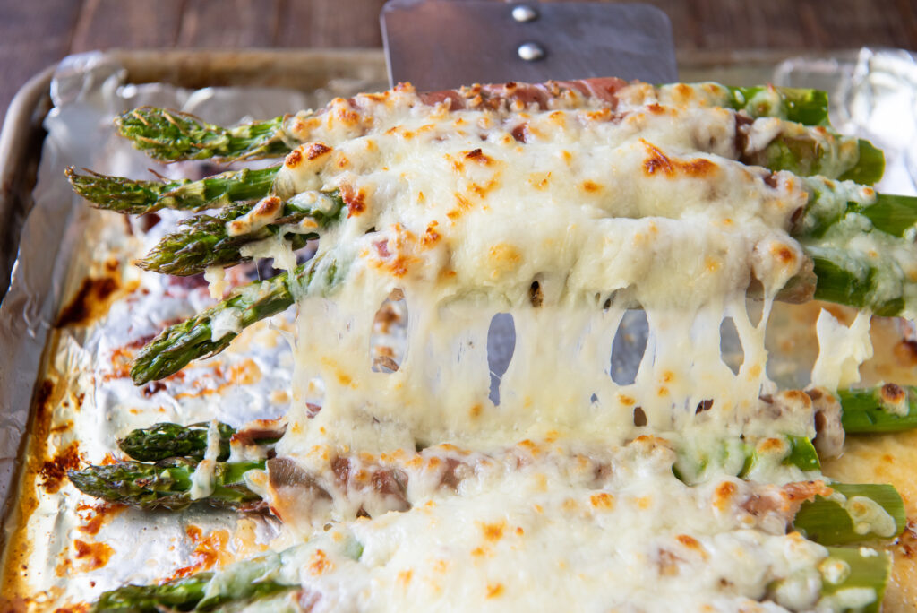 Looking for asparagus bake recipes, check out this one! This Cheesy Baked Asparagus with Prosciutto recipe is an easy and delicious side dish that is perfect for any occasion!
