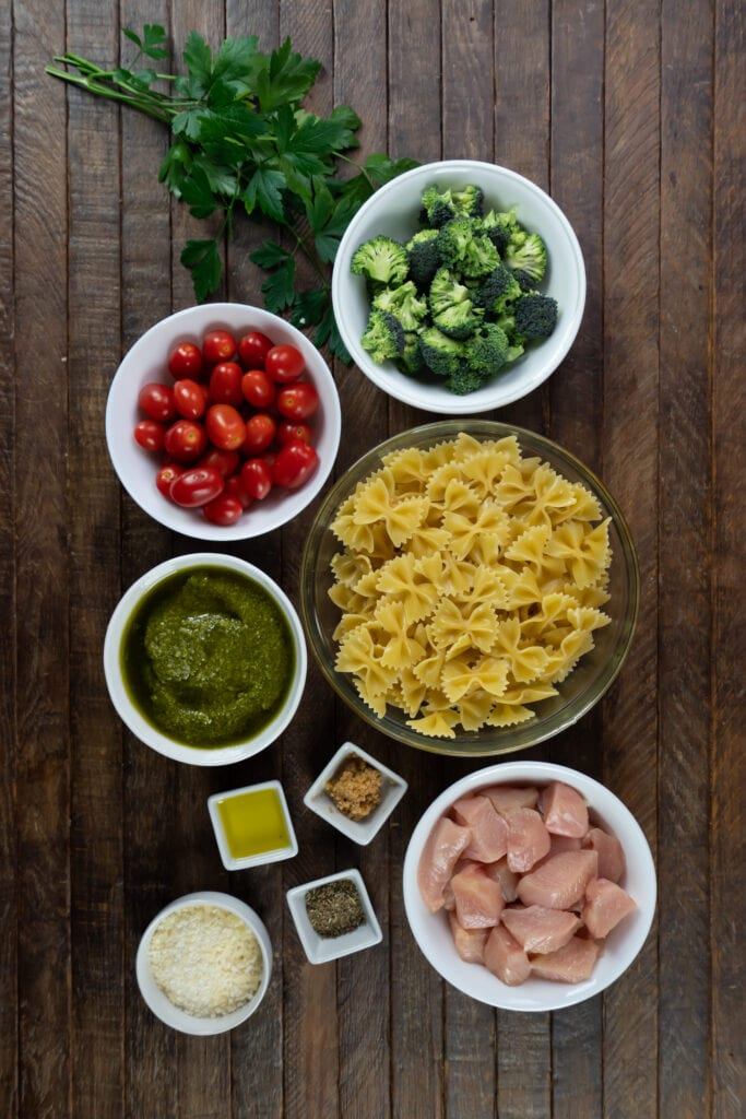 This chicken pesto pasta with tomatoes recipe blends the great flavor of pesto with bowtie pasta, cherry tomatoes, broccoli and parmesan cheese for a delicious dinner in 30 minutes.
