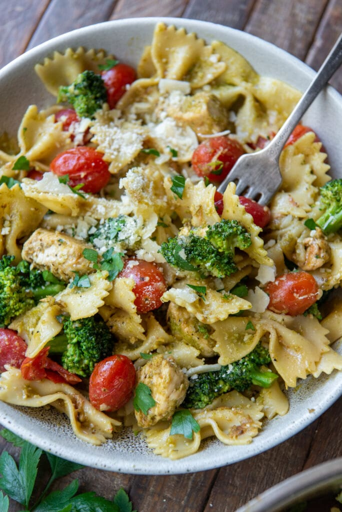 This chicken broccoli pesto pasta recipe blends the great flavor of pesto with bowtie pasta, cherry tomatoes, broccoli and parmesan cheese for a delicious dinner in 30 minutes.