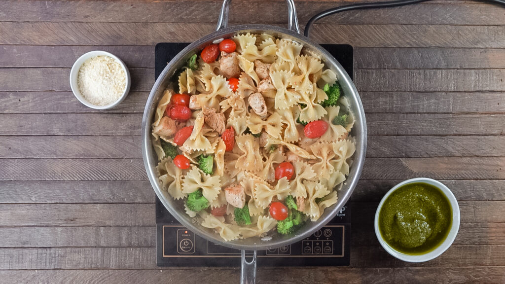 This chicken pesto bowtie pasta recipe blends the great flavor of pesto with bowtie pasta, cherry tomatoes, broccoli and parmesan cheese for a delicious dinner in 30 minutes.