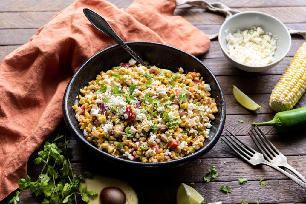 This delicious Mexican corn salad recipe with mayo is the perfect side dish for any Mexican themed meal or as a cool side dish to a summer barbeque.