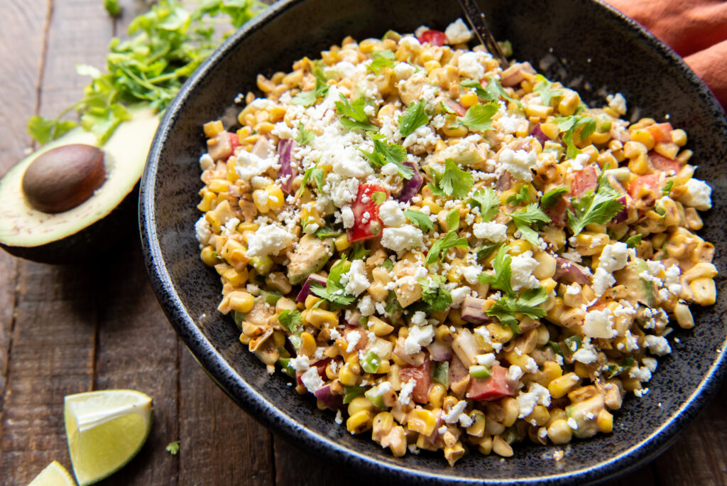 This delicious Mexican Corn Salad recipe is the perfect side dish for any Mexican themed meal or as a cool side dish to a summer barbeque.