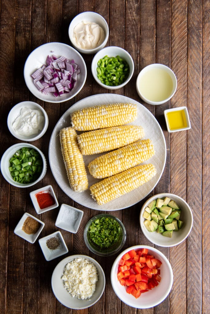 Looking for an esquites recipe? Here is a delicious one! This delicious Mexican Esquites Salad recipe is the perfect side dish for any Mexican themed meal or as a cool side dish to a summer barbeque.