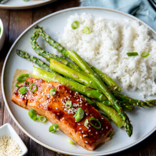 This Asian Salmon recipe tops healthy salmon fillets with a boldly flavored Asian glaze of hoisin sauce, garlic, and siracha.
