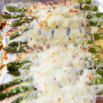This Cheesy Baked Asparagus with Prosciutto recipe is an easy and delicious side dish that is perfect for any occasion!