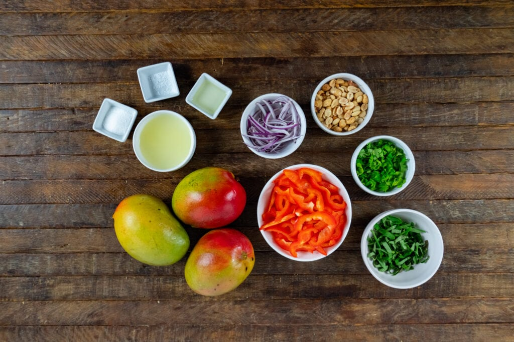 Wanting a salad with mango? Look no further! This Mango Salads recipe has sweet mangoes, crisp bell peppers and onions, and a tangy lime dressing that all pairs together perfectly!