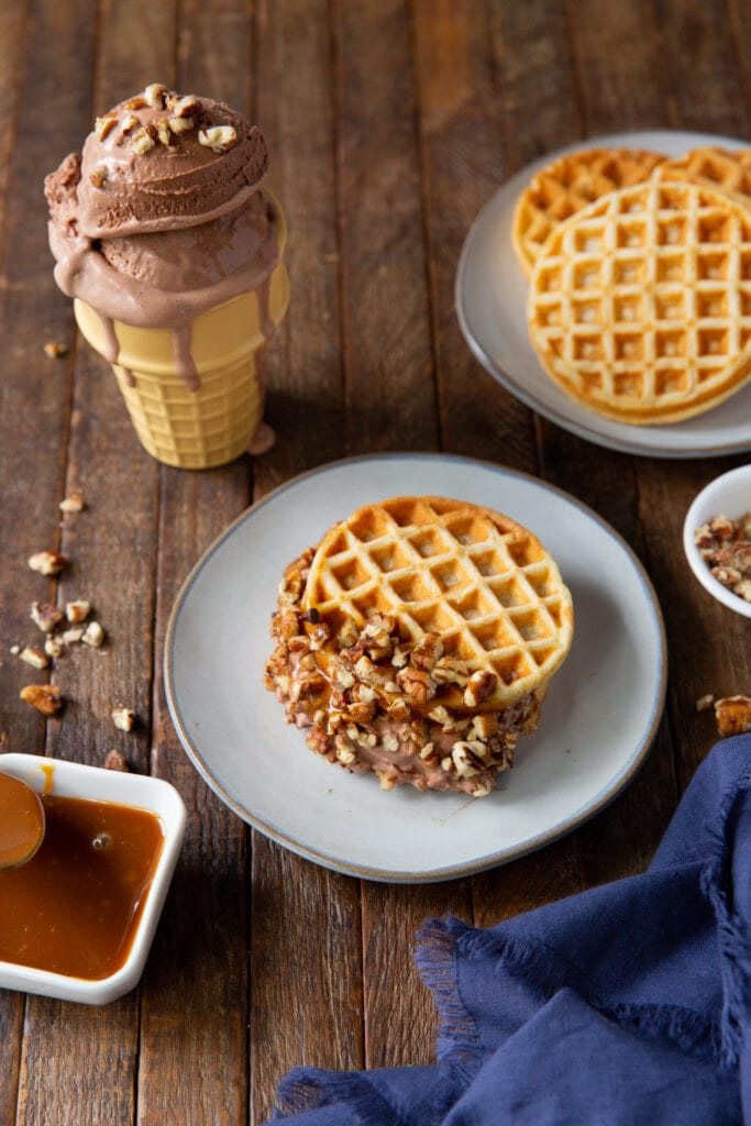 Wanting ice cream and waffles? This homemade waffle ice cream sandwich recipe is a delicious way to cool off in the summer with your favorite ice cream and toppings!