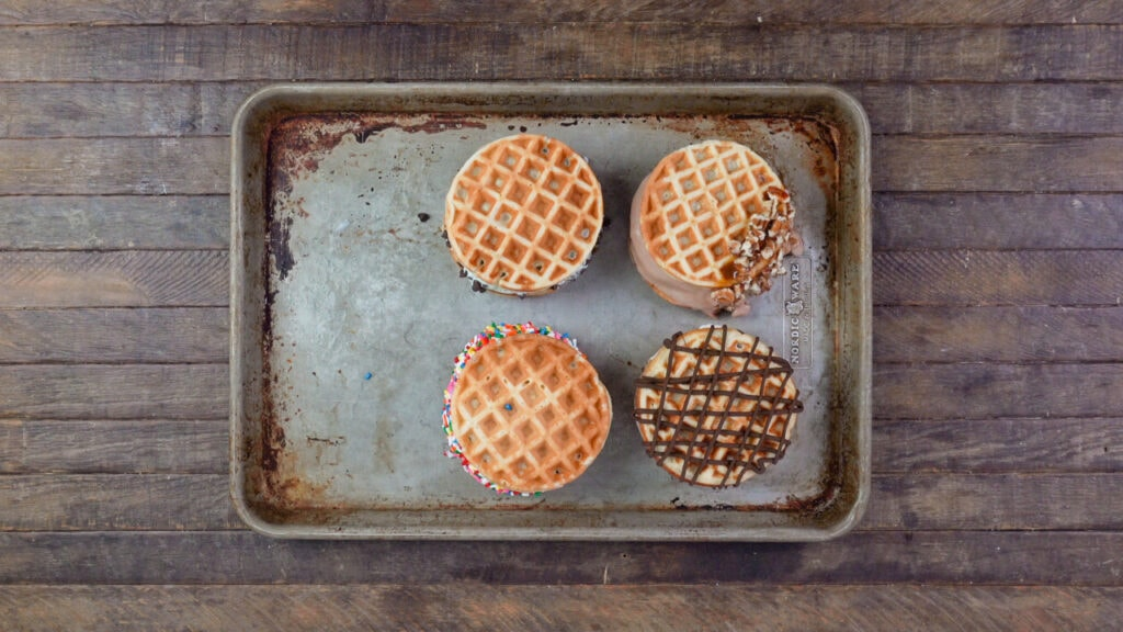 Wanting a waffle with ice cream? This homemade waffle ice cream sandwich recipe is a delicious way to cool off in the summer with your favorite ice cream and toppings!