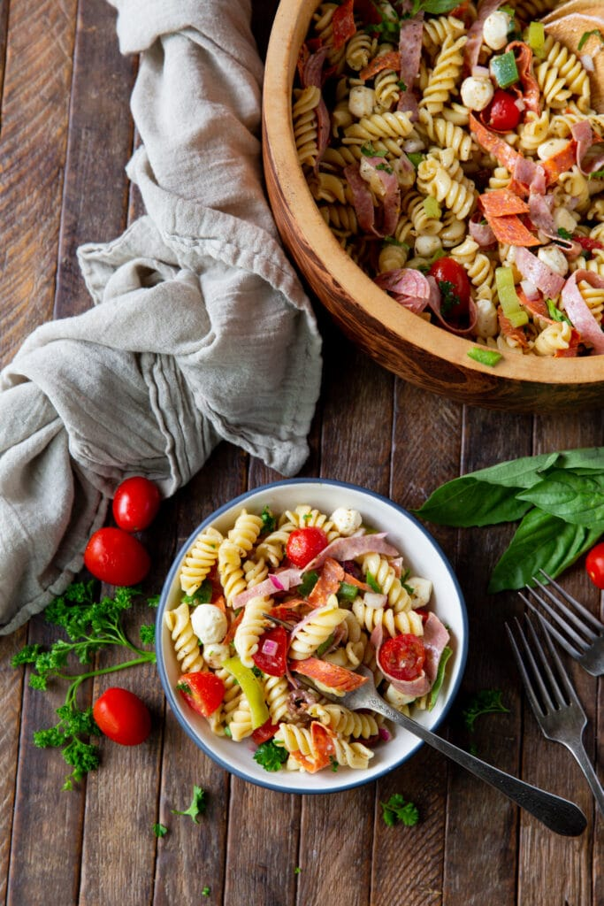 Looking for pasta salad recipes? This Italian Pasta Salad Recipe is a burst of color filled with salami, pepperoncini, Kalamata olives, mozzarella and so much more!