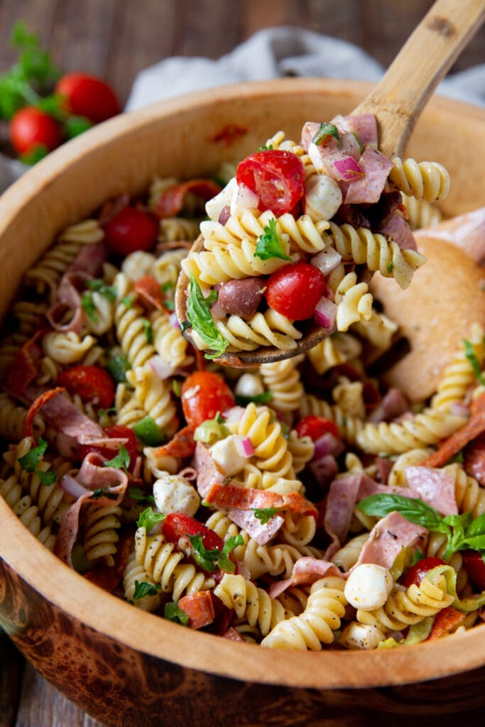 Looking for pasta salad italian dressing? This Italian Pasta Salad Recipe is a burst of color filled with salami, pepperoncini, Kalamata olives, mozzarella and so much more!