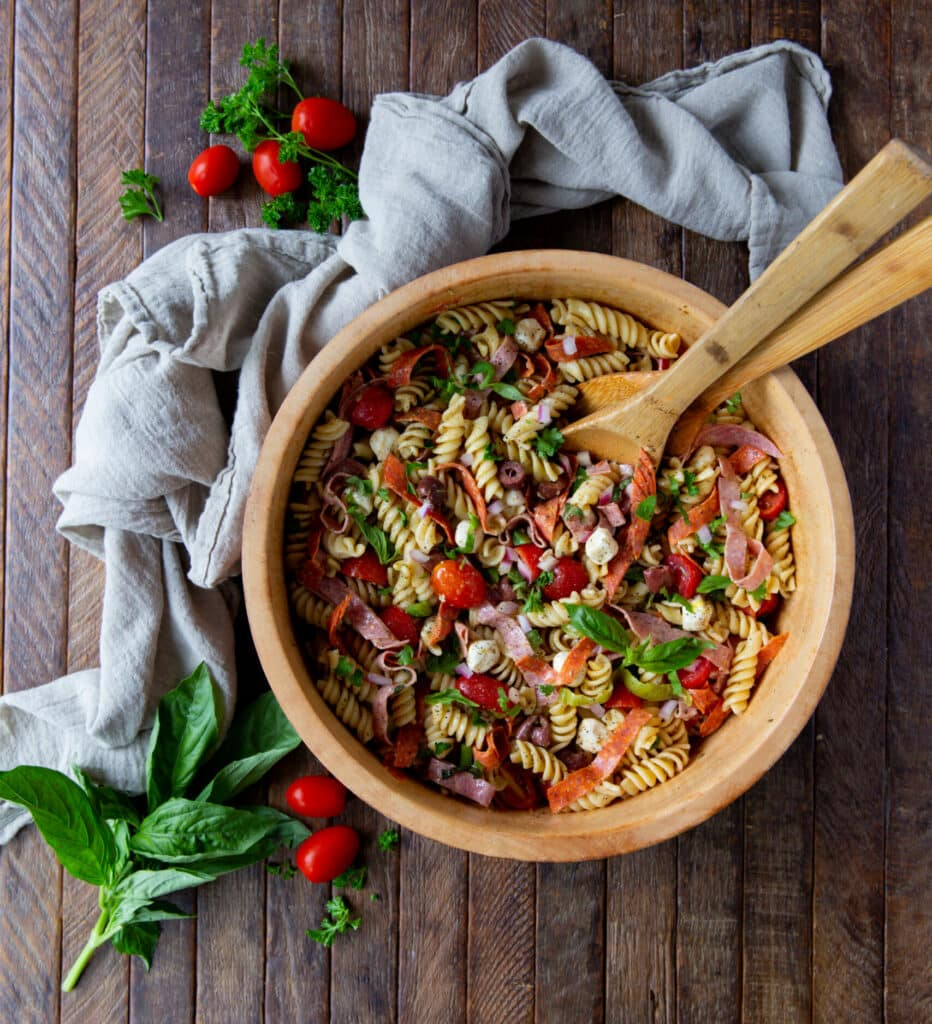 This easy Italian Pasta Salad Recipe is a burst of color filled with salami, pepperoncini, Kalamata olives, mozzarella and so much more!