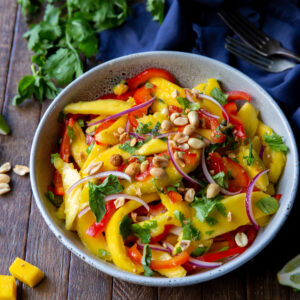 This Mango Salad recipe has sweet mangoes, crisp bell peppers and onions, and a tangy lime dressing that blends together perfectly for a fresh, delicious taste!