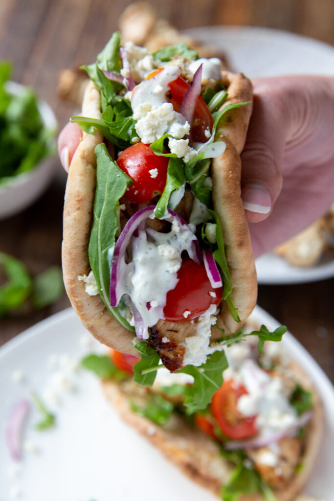 This Greek souvlaki recipe chicken is made with a delicious lemon, garlic and spice marinade and so tasty when loaded onto a pita bread with your favorite toppings, like lettuce, tomatoes, onion, tzatziki sauce and feta cheese!