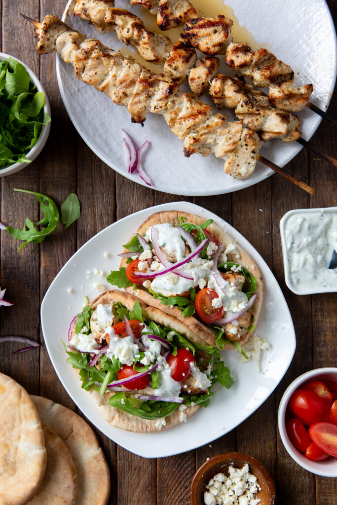 This Greek Souvlaki Chicken recipe is made with a delicious lemon, garlic and spice marinade and so tasty when loaded onto a pita bread with your favorite toppings, like lettuce, tomatoes, onion, tzatziki sauce and feta cheese!