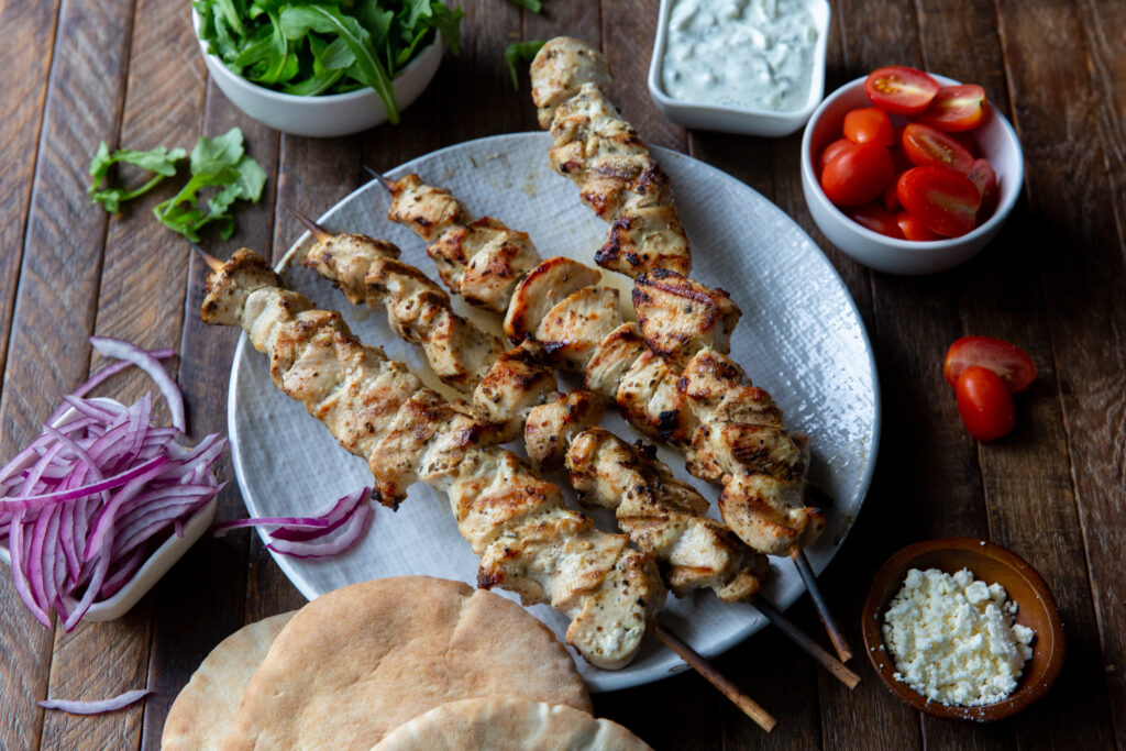 This Greek recipe for Souvlaki Chicken is made with a delicious lemon, garlic and spice marinade and so tasty when loaded onto a pita bread with your favorite toppings, like lettuce, tomatoes, onion, tzatziki sauce and feta cheese!