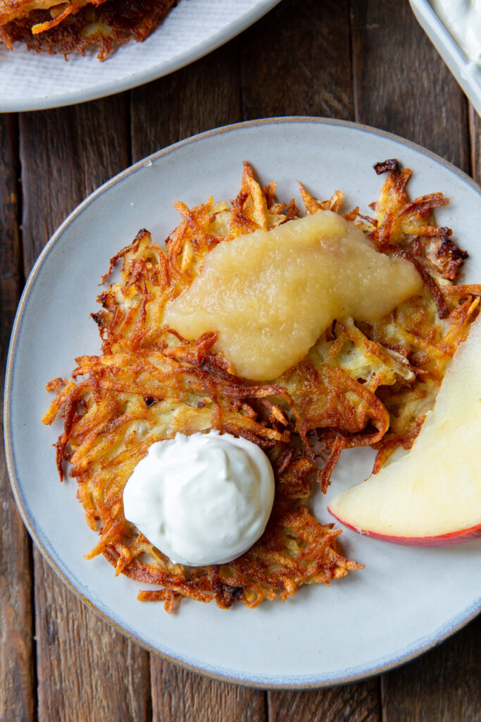 Looking for potato pancakes German? This classic German Potato Pancake recipe, also known as Kartoffelpuffer, is a savory and crispy side dish that can be served with any meal!