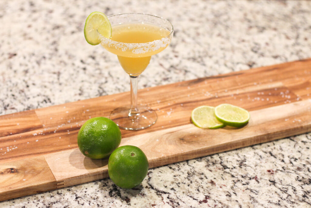 Looking for freshly squeezed lime juice for your Italian Margaritas? This classic Italian Margarita Recipe combines tequila, amaretto liquor, lemon and lime juice for a perfect tangy drink!