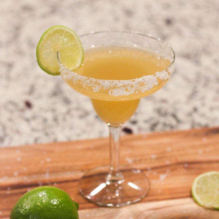 This classic Italian Margarita Recipe combines tequila, amaretto liquor, lemon and lime juice for a perfect tangy drink!