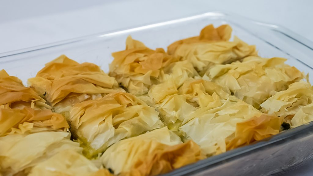 Looking for homemade spanakopita? This Spanakopita recipe is a combination of the traditional Greek flavors of Spinach and Feta to make a delicious Greek Spinach Pie!