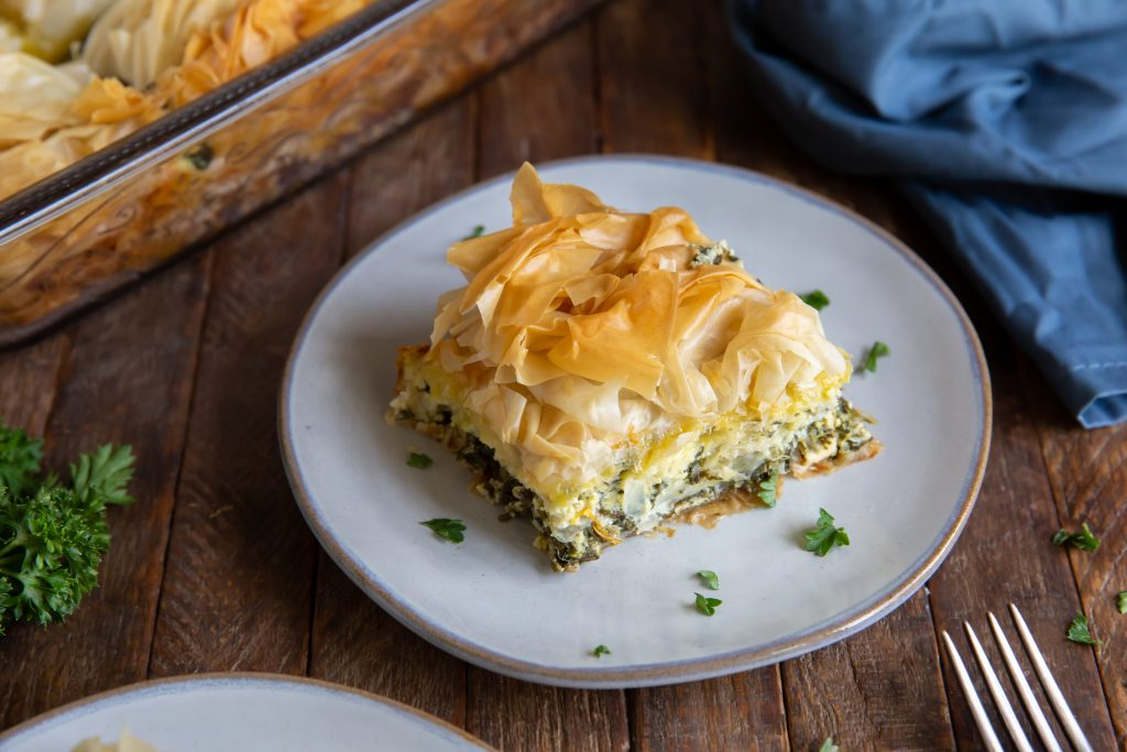 Wanting an authentic spanakopita recipe? This Spanakopita recipe is a combination of the traditional Greek flavors of Spinach and Feta to make a delicious Greek Spinach Pie!