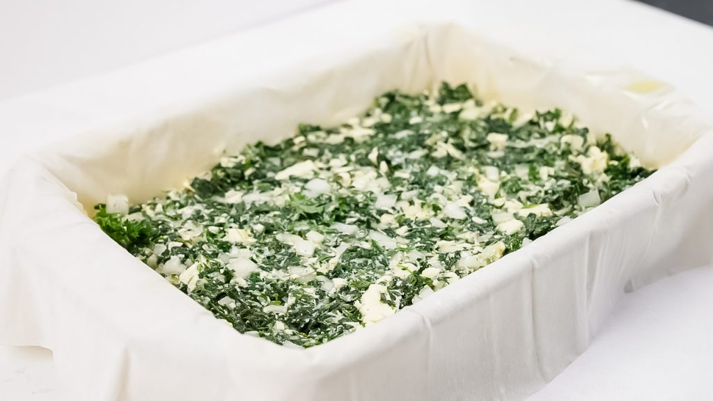 Looking for Spinach greek pie? This Spanakopita recipe is a combination of the traditional Greek flavors of Spinach and Feta to make a delicious Greek Spinach Pie!